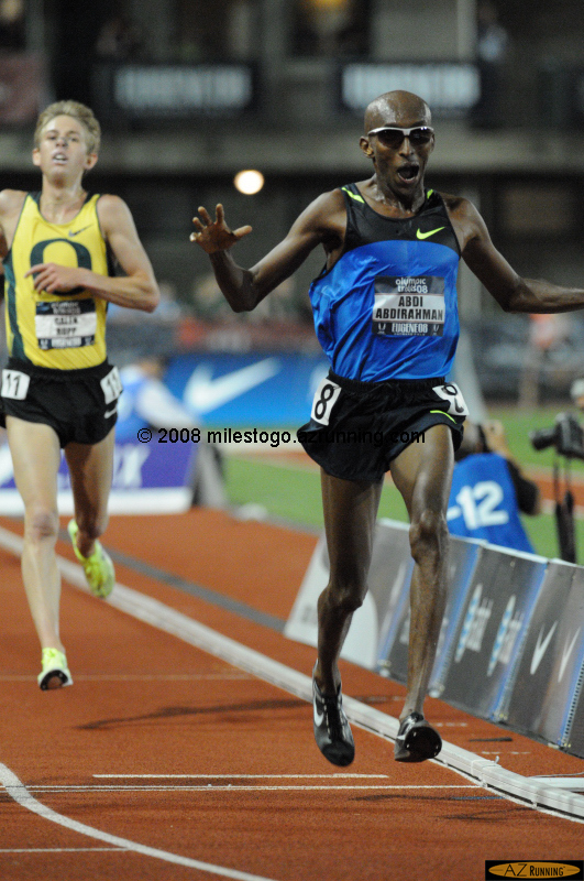 Abdi celebrates his win in the 10,000 meter run