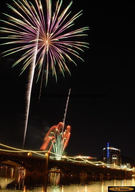 The Mill Avenue Bridge and Tempe Town Lake provide a colorful backdrop for Tempe's annual Independence Day fireworks display