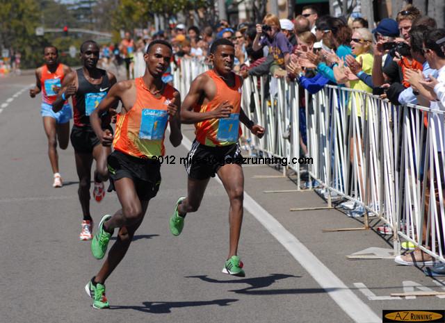 Dejen Gebremeskel rounds the last corner ahead of Hagos Gebrhiwet
