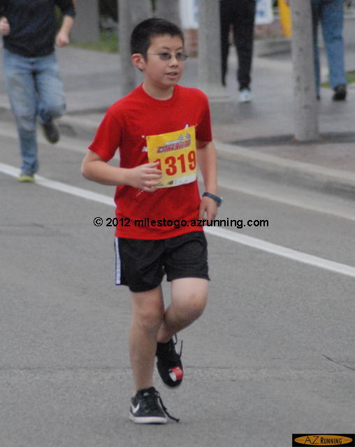 My younger nephew Nick set a PR in the Age 11 race. Good run, Nick!