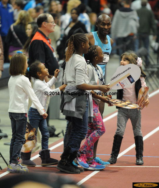 Lagat celebrated the victory with a group of young fans.