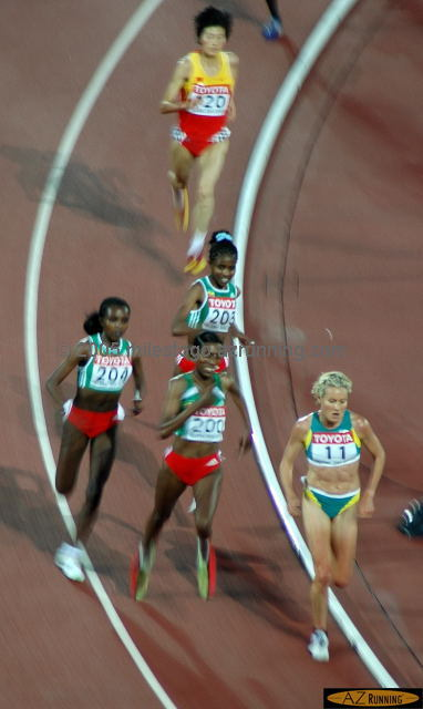 Tirunesh Dibaba and Berhane Adere lead the Ethiopian juggernaut on the bell lap of the 10,000 meters